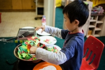 Giving children the space to re-create the things that they see around them daily gives depth to their play, a depth that comes from a place of re-creation, creation and imagination. Here is imagination in process, creating a beautiful meal to help feed his classroom.
