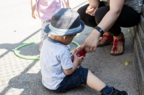 Literature is woven throughout high quality programs offering children language opportunities in all sorts of different environments and moments. Here a toddler reaches for his friend's water bottle and starts sounding out the name by reading each letter, with the support of his Early Childhood Educator.